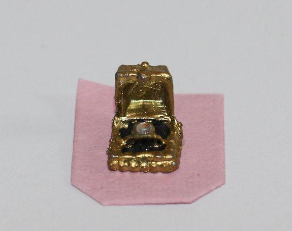 Gold diamond ring in case
