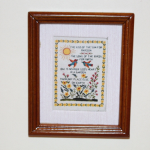 Framed picture of cross stitch
